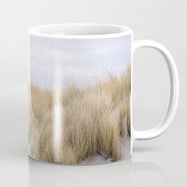 Field of grass growing in the sand Coffee Mug