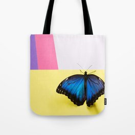 Morpho butterfly sitting on the colored background Tote Bag