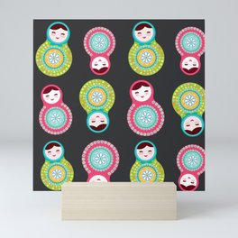 dolls matryoshka on black background, pink and blue colors Mini Art Print