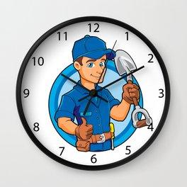 Cartoon plumber holding a big shovel. Wall Clock