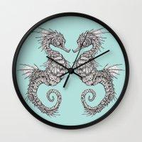 seahorse Wall Clocks featuring seahorse by Caitlin Hackett