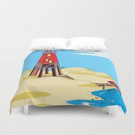 A Lighthouse on a Sandy Beach on a Sunny Day Duvet Cover