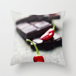 Dark chocolate with chili pepper over wooden background Throw Pillow