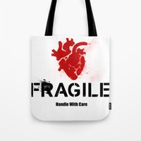 anatomical heart Tote Bags featuring Fragile Anatomical Heart(RED) by J ō v
