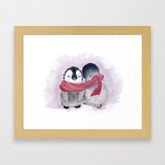 Penguin cuddle Framed Art Print