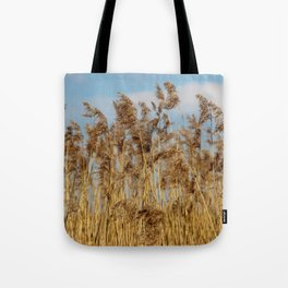 Lenz gently blowing the stalks Tote Bag
