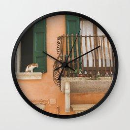 The cat on the balcony Wall Clock