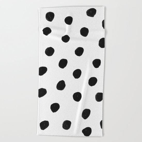 in black dots Beach Towel