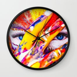 Women with paint on her hands and face Wall Clock
