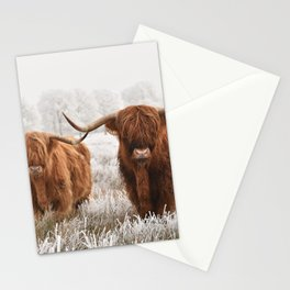 Hairy Scottish highlanders in a natural winter landscape. Stationery Cards