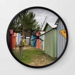 colored beach huts Wall Clock