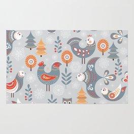 Winter seamless pattern with birds, trees, snowflakes. The Scandinavian style. Folk art. Rug