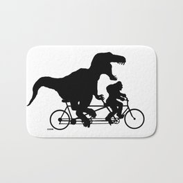 Gone Squatchin cycling with T-rex Bath Mat