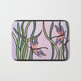 dragonflies in  a pastel color background Bath Mat