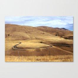 Windy rural road through wind farm Canvas Print