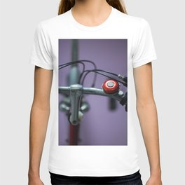Red bell on purple T-shirt