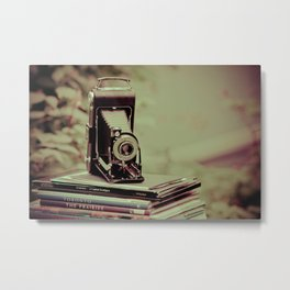 There's something about cameras, book and travel... Metal Print