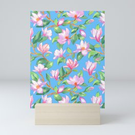 Blooming magnolia with sky blue background Mini Art Print