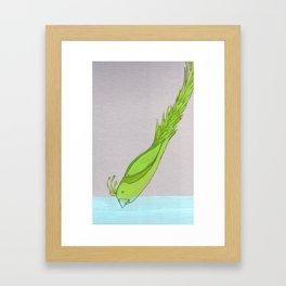 green bird diving Framed Art Print