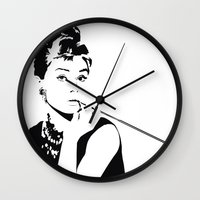 audrey hepburn Wall Clocks featuring AUDREY HEPBURN by MATT WARING