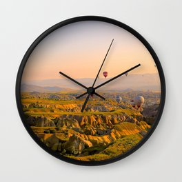 Hot Air Balloons Over a Beautiful Rugged Terrain Wall Clock