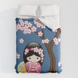 Japanese Spring Kokeshi Doll on Blue Comforters