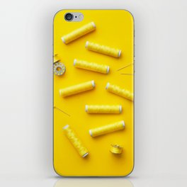 Colorful yellow thread spools over bright yellow background iPhone Skin