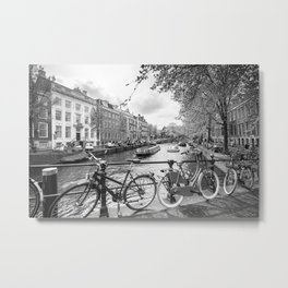 Bicycles parked on bridge over Amsterdam canal Metal Print