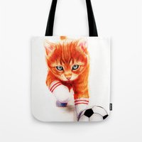soccer Tote Bags featuring Soccer Kitty by Isaiah K. Stephens