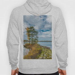 Picture of blue sky over autumn lake with stones in the water. Hoody
