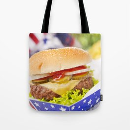 Burger with fries on an outdoor table in bright light Tote Bag