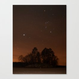 Sirius and Orion over an island Canvas Print