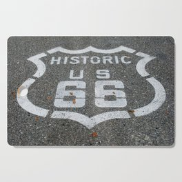 Route 66 sign on the road Cutting Board
