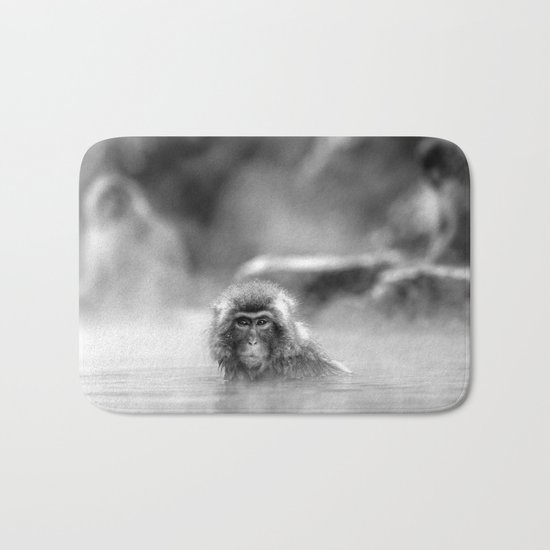 Black and White Macaque at a hot spring Bath Mat