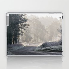 Rays of sunlight and frost along a remote country road. Norfolk, UK. Laptop & iPad Skin