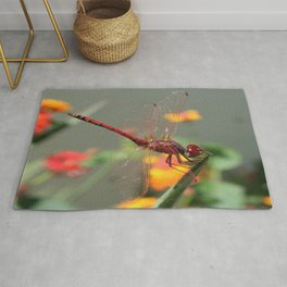 Red Skimmer or Firecracker Dragonfly With Lantana Background Rug