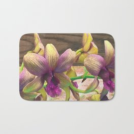 The orchids are blooming. Bath Mat