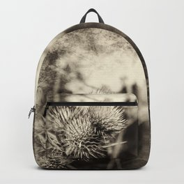 Beautiful thistle growing wild and sepia texture Backpack