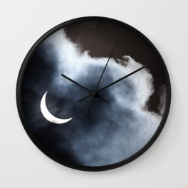 Partial solar eclipse viewed through clouds Wall Clock