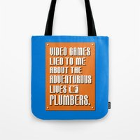 video games Tote Bags featuring Video Games Lied To Me by Made With Awesome