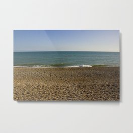 Evening Tide on a cobbled beach Metal Print