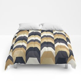 Stacks of Gold and Navy Comforters