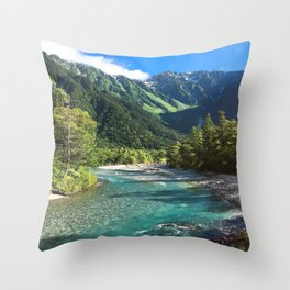 River flowing in front of snow covered mountain Throw Pillow