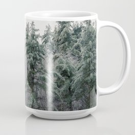 Tall ice covered evergreen trees fill the mountain tops Coffee Mug