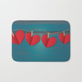 Red paper hearts tie to a rope Bath Mat