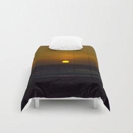 Sunset across the Ocean Comforters