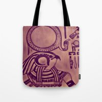 egyptian Tote Bags featuring Egyptian (Horus) by Aaron Carberry