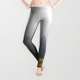 Autumn forest wrapped in fog Leggings
