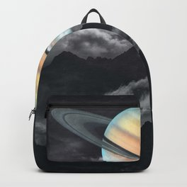 Saturn above mountains Backpack