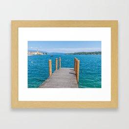 Wooden pier on Lake Garda, Italy Framed Art Print